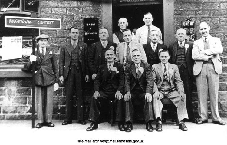 First-band-concert-held-in-Roughtown,-committee-members-outside-the-Lower-Church-Inn,-Stockport-Road